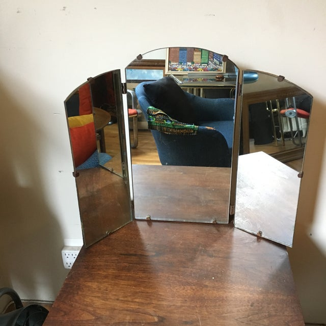 Great for any dresser or vanity - this mirror will add character to your space. It has beautiful curves and is in good...