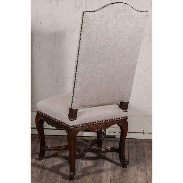 Pair of Régence side chairs hand-carved in oak. Mid-19th century, France. Adorned by carved rocaille (shell and sinuous...