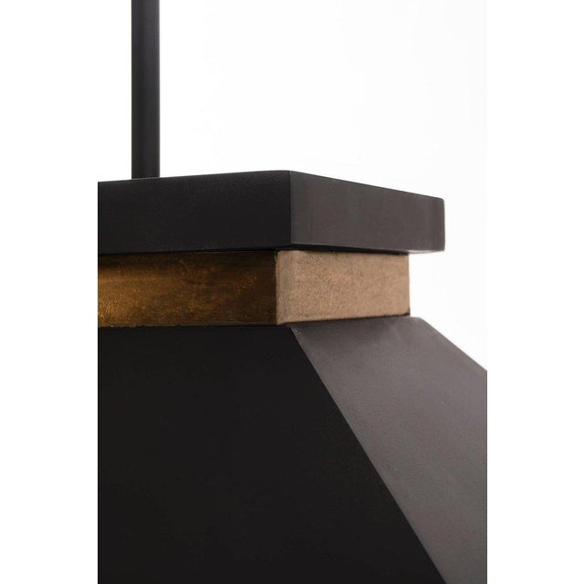 Italian design with brass edge detail and matte black shade.