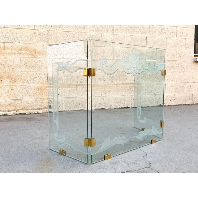 Rare 1980s modern glass fireplace screen with brass hinges by Danny Alessandro. This tri-fold screen features custom glass...