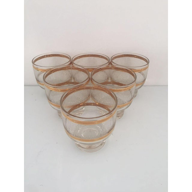 Mid century gold and clear textured set of six short cocktail glasses , no makers mark in excellent condition. Dimensions...