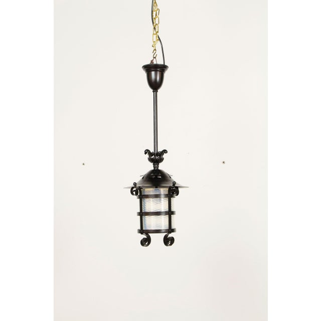 Beautiful original swirled blown glass lantern. Originally gas, but has been electrified for exterior use.