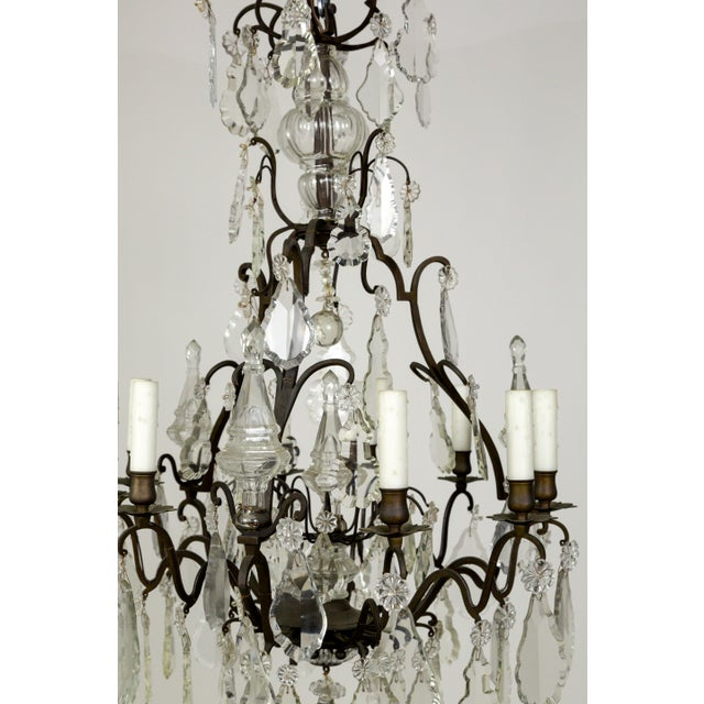 A beautiful pair of Parisian, 1920's 2nd Empire Style chandeliers with a darkened brass structure. They are decked with...