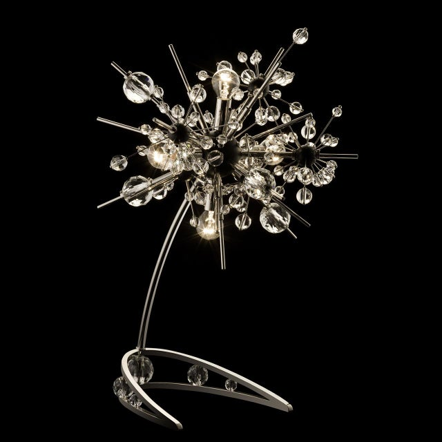 """The """"Starburst"""" table lamp designed by Johannes Rath is inspired by the inspired by the chandeliers at the Metropolitan..."""