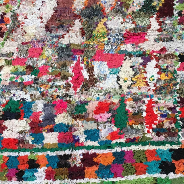 This Boucherouite Rug is a genuine article produced by women in the areas around Marrakesh and in the Atlas Mountains....