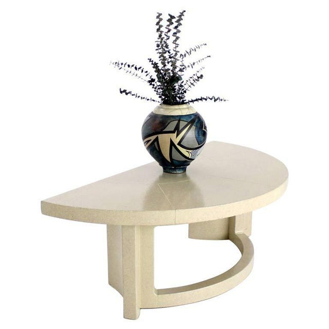 Very nice all sealed cork demilune console table by Paul Frankl. Perfect for the entryway.
