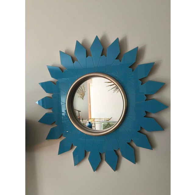 Gorgeous turquoise glass starburst mirror purchased from an estate sale at the Algonquin Hotel in New York City. These...