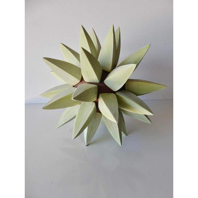 """A """"stellar"""" glazed stoneware sculpture by contemporary American artist Titia Estes. In this iteration of a stellar..."""