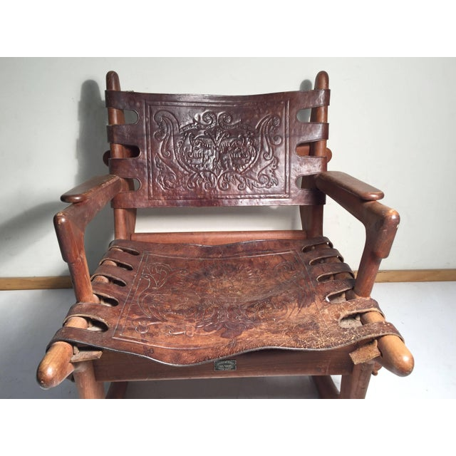 Vintage rocker by Angel Pazmino. Untouched . In original finish with tooled leather backrest and seat. Fully signed. In...