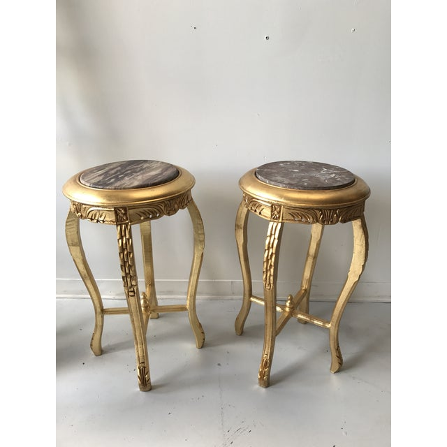 Gilded side table marble top tables with reticulated design.
