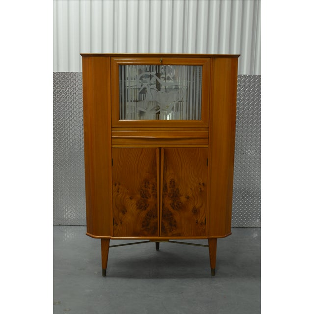 This beautiful solid oak corner bar cabinet is part of a larger dining room set that was custom made in Stavanger, Norway...