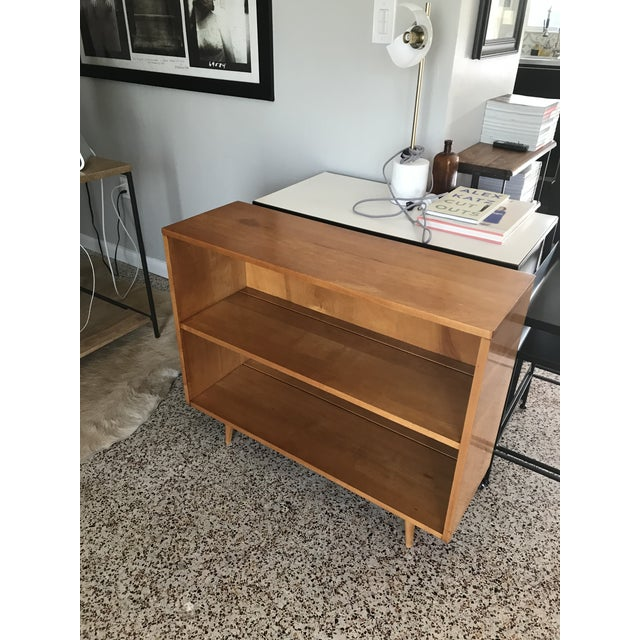 Stylish, versatile small bookcase for the Planner Group designed by architect and furniture designer Paul McCobb. Incised...