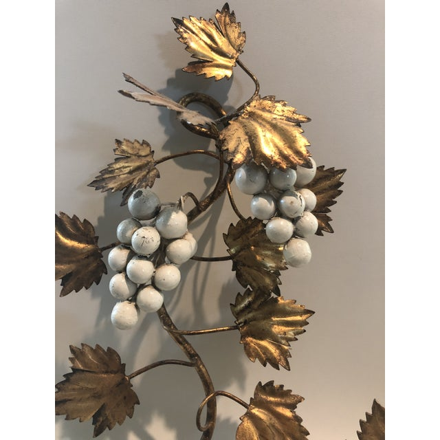 Classic wall hung double candleabra with painted metal grape cluster and leaves.