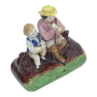 Antique Staffordshire Musician & Boy Figurine For Sale