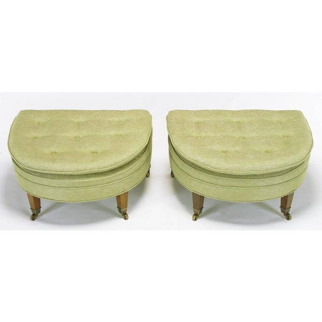 Very well executed pair of demilune ottomans or benches by Kittinger. They have a slight slope to the seating surface,...