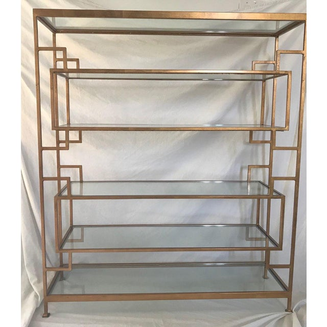 Doris Etagere by Worlds Away. 6 shelf gold leaf etagere with glass shelves by Worlds Away. Retails for $1700 Top and...