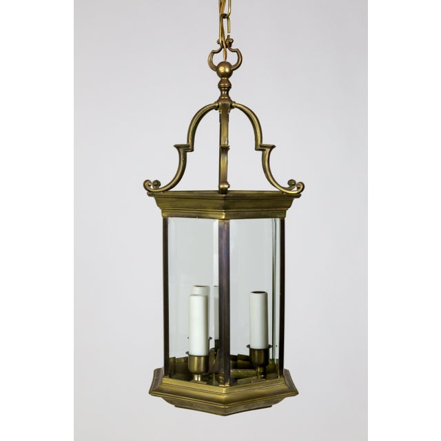 An Italian, Neoclassical, 6-sided lantern with thick, beveled glass. Composed of heavy bronze and brass, with pagoda-esque...