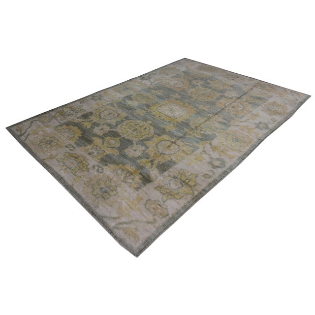 Hand knotted Oushak rug made by Aara Rugs Inc. This stunning allover design rug is made of 100% wool, dyed with pigment...