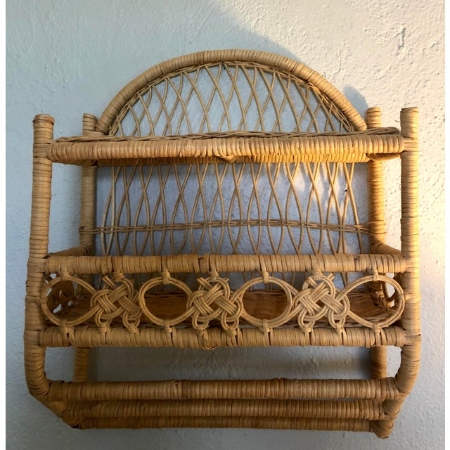 Vintage Bohemian honey-toned rattan and wicker two-tier wall shelf with double towel