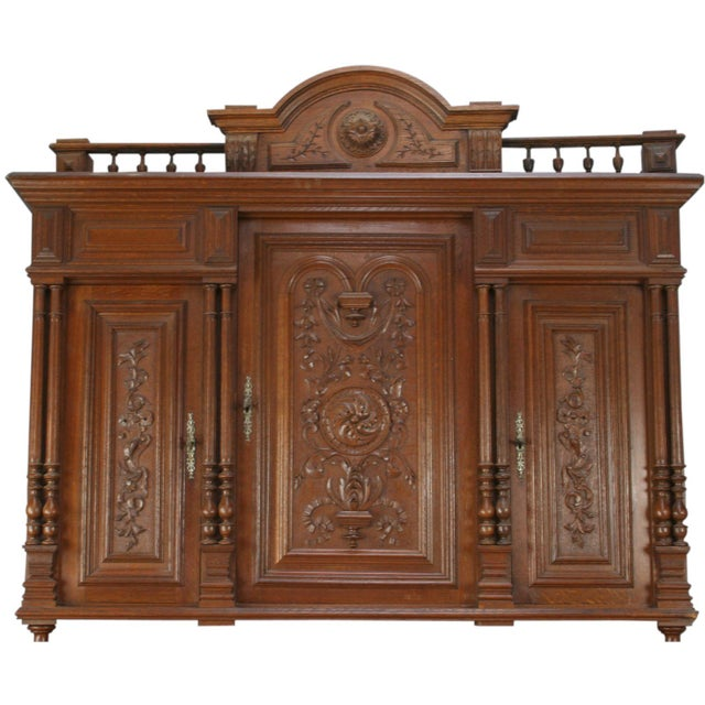 Beautiful carvings and elegant drawer pulls and lock plates make this antique French Renaissance Henry II style oak buffet...