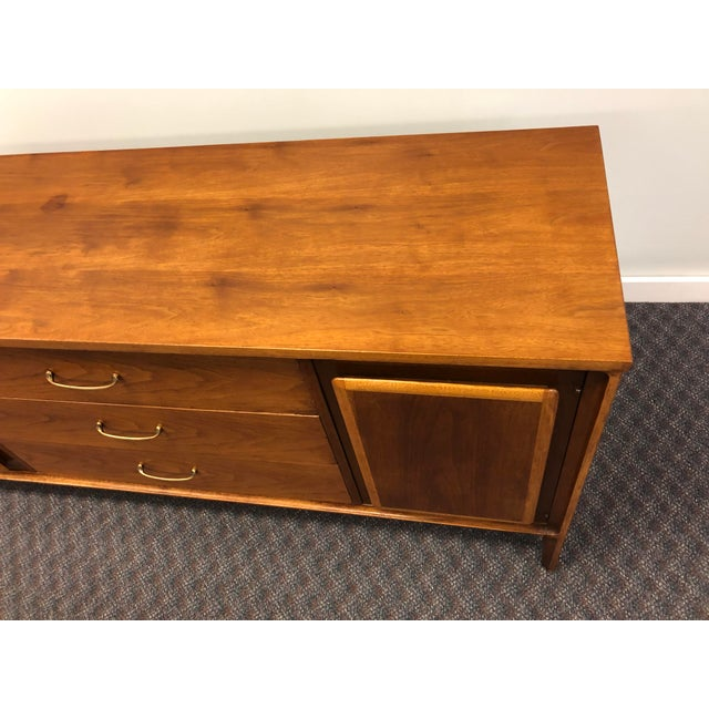 Vintage Mid Century Modern Credenza. Nice sculpted wood panels on both doors. Metal center drawer pulls. Wood with veneer....