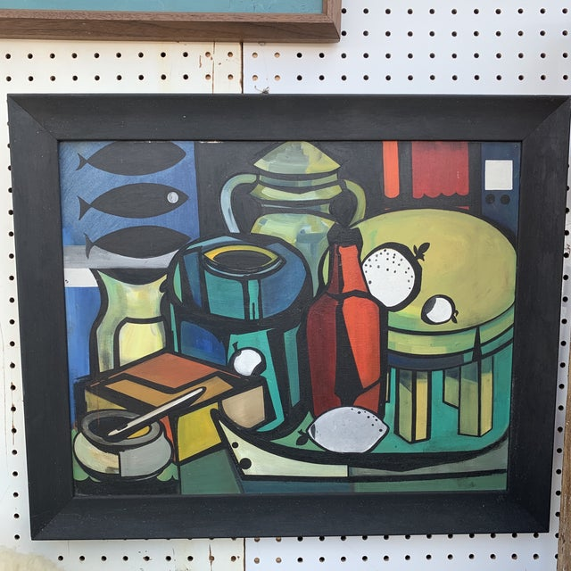 Lovely still life in bright colors in a period black wooden frame.