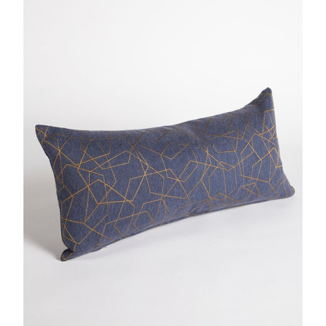 """This blue and gold geometric lumbar pillow measures 12""""x24"""". The iridescent gold hexagonal pattern mixed with the subtle..."""