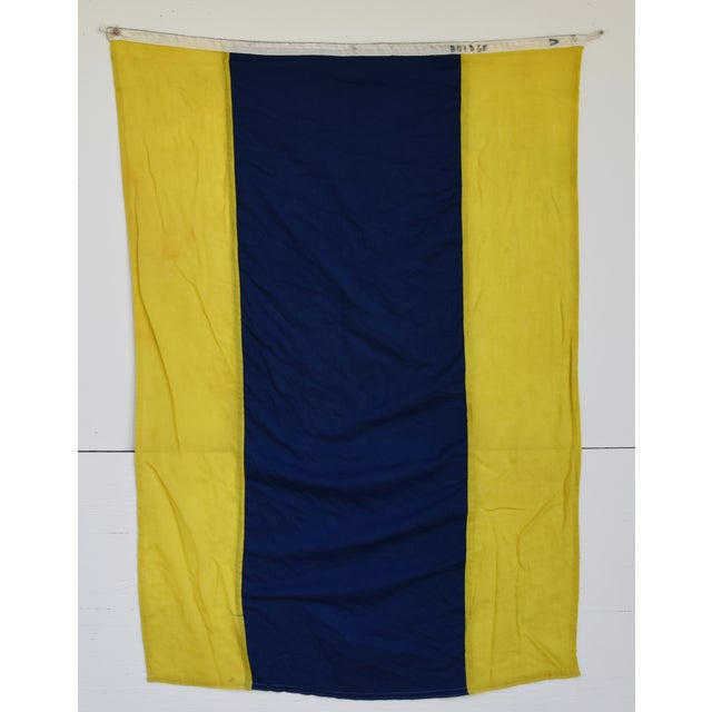 "Vintage yellow and blue maritime nautical naval signal ""D Delta"" code flag. This flag is the international maritime..."