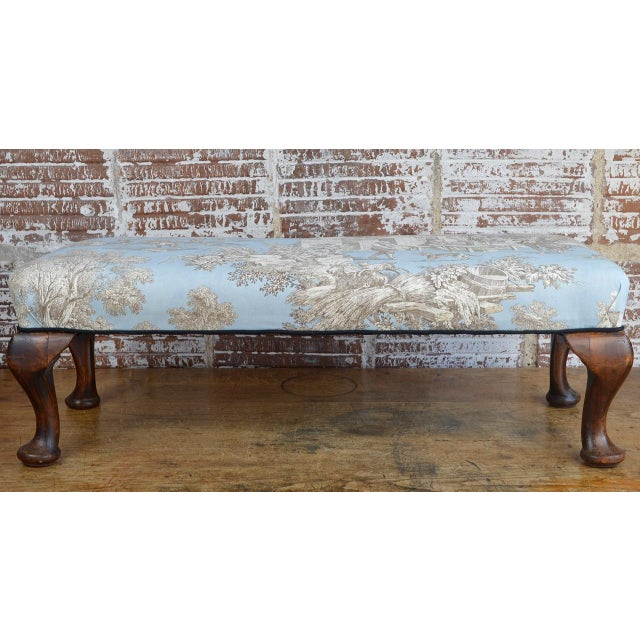 Late 19th century Queen Anne style upholstered long footstool with newer upholstery. Overall surface scratches and scuffs...