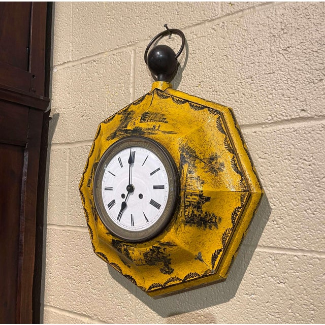 This feminine colorful clock was created in France, circa 1870. Octagonal in shape, and made of metal and brass, the time...