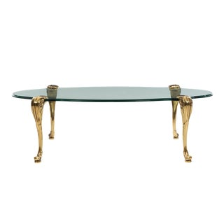 Glass Coffee Table With Ornamental Saber Legs For Sale