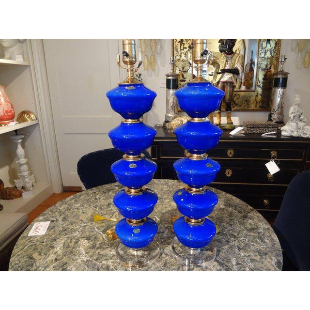 Great pair of cobalt blue stacked ball Venetian glass lamps, circa 1960. Each sphere is separated with brass fittings....