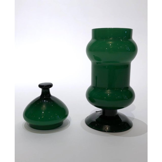 1970s emerald green cast glass vase with lid.