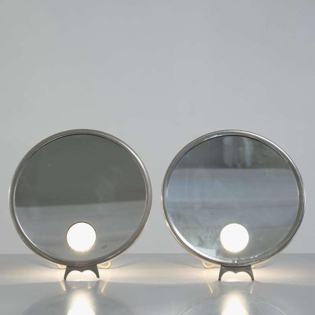 Pair of freestandng Brot Mirophar mirrors with nickel plated frame and illuminating glass. These mirrors were used in...