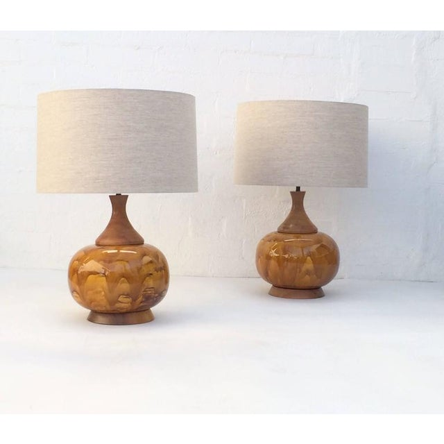 Pair of large-scale drip glazed ceramic lamps with walnut bases. These lamps are absolutely stunning! Newly re-wired with...