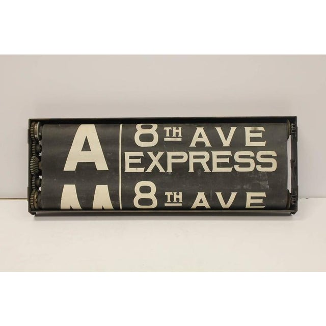 Early 20th century New York City train schedule sign with original metal frame.