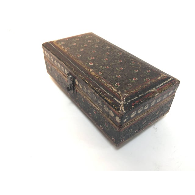Hand-painted Rajhastani decorative footed tea box. Hand-painted rectangular shape wood with hinged lid and decorated with...