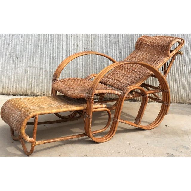 About A height-adjustable chaise longue made of a bentwood frame with woven rattan. The backrest can be placed in four...