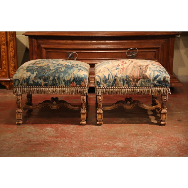 Large pair of antique stools from southern France; crafted circa 1870 and almost square in shape, the elegant fruit wood...