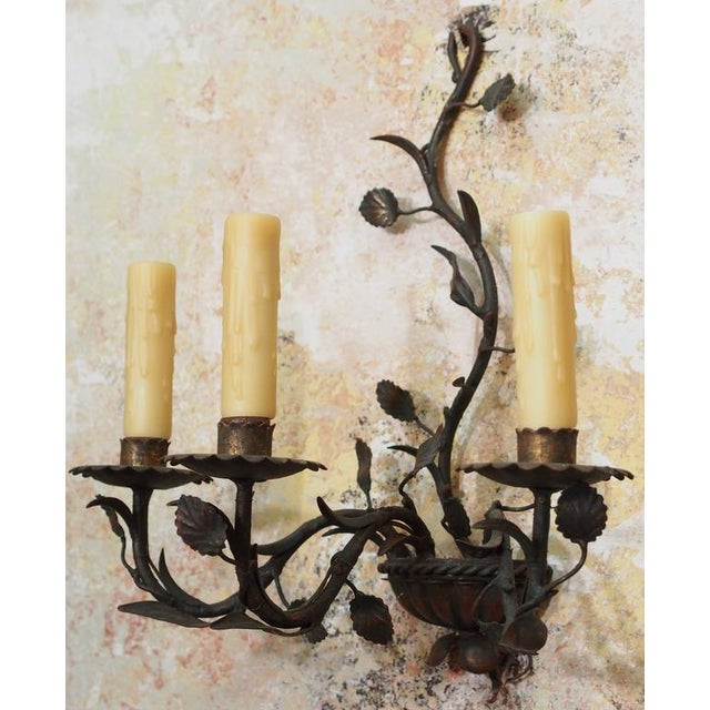 Pair of antique Italian iron wall sconces.