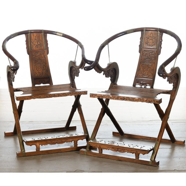 A pair of beautiful Chinese carved horseshoes and folding chairs. A beautiful piece that will add to your décor!