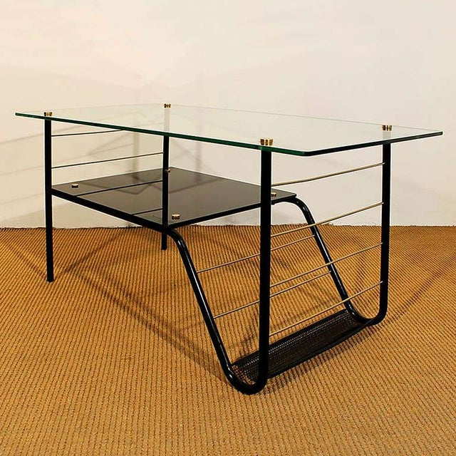 Original coffee table, black lacquered metal structure, glass, black opaline and brass hardware, magazine rack. Design:...