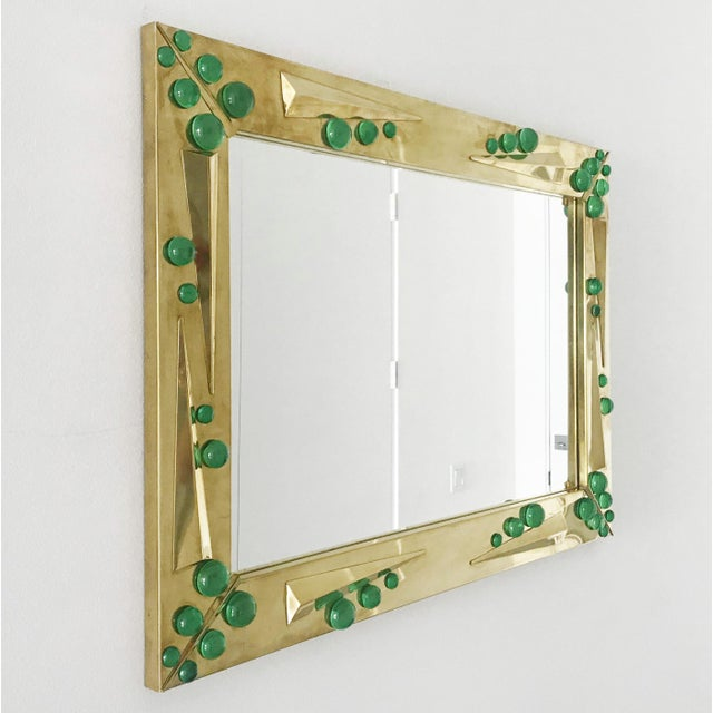 Rectangular mirror in semi-polished brass finish decorated with additional brass inserts and green Murano glass elements /...