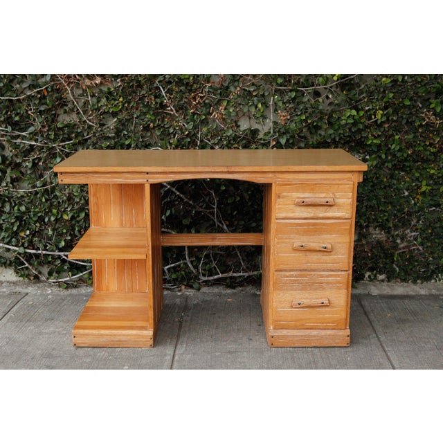 Rancho Monterey wood writing desk with side shelves and drawers. Laminate top and whitewash groove detail.