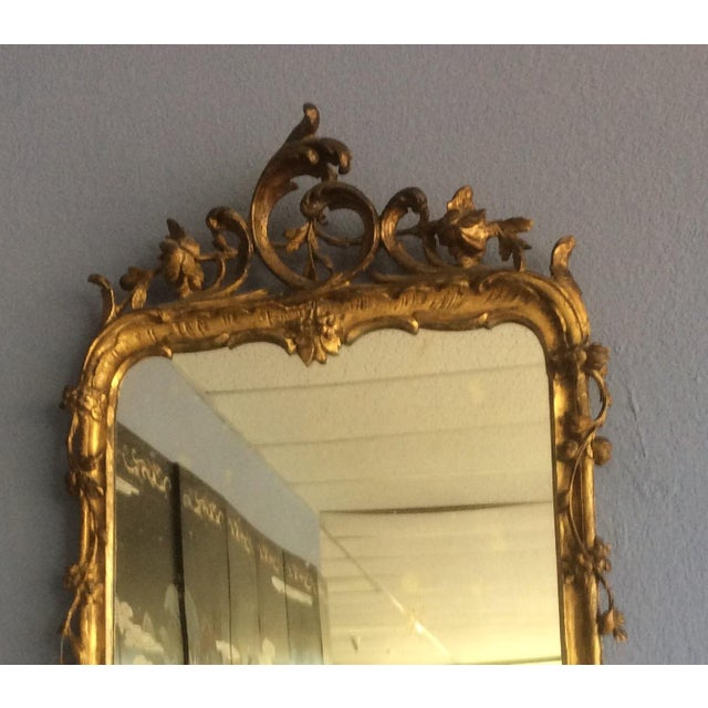 Beautiful antique Giltwood mirror with original glass mirror plate and floral decoration. This has minor losses and the...