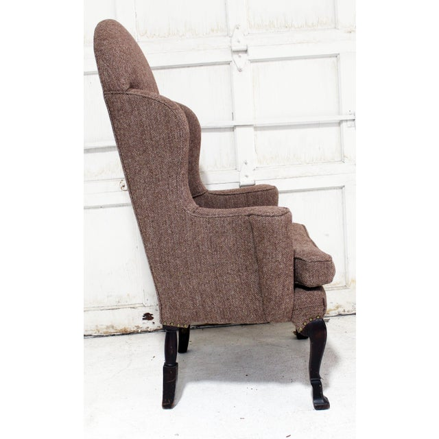 Unique lines for a wing chair filled with hay batting.