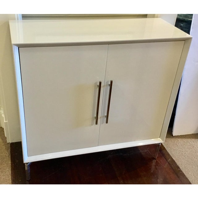Chic Contemporary white lacquer Mitchell Gold Bob Williams Ming storage chest, linear chrome accents, three shelves,...