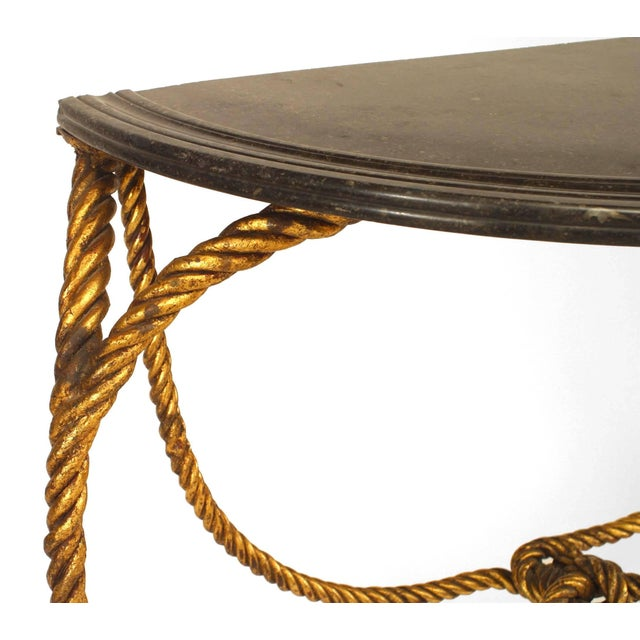 Hollywood Regency rope and tassel design gilt metal half round console table with marble top (20th century).