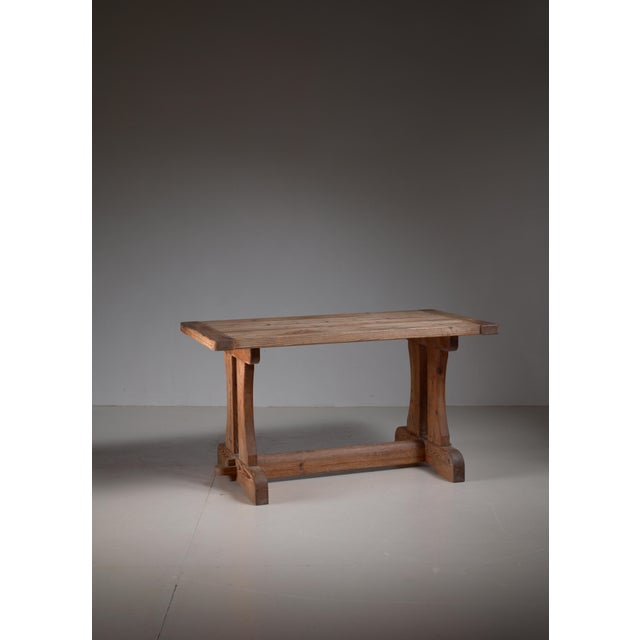 A low 'Berga' console table in robust pine by David Rosén for Nordiska Kompaniet, 1944. The pine has a lovely patina and...