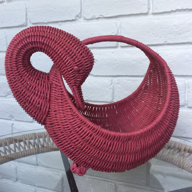 A painted wicker swan basket. Use as a vase planter breadbasket. Very well done.